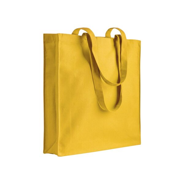 yellow color cotton bag with long handles
