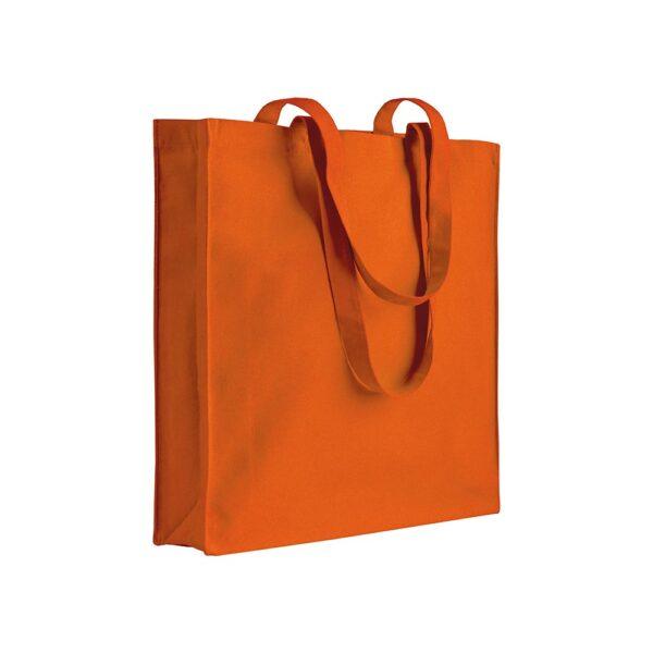 orange color cotton bag with long handles